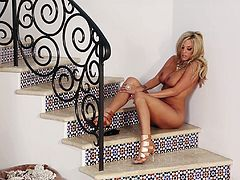 Gisele does a hot little striptease on the stairs, but leaves her high heels on as she poses while relaxing in the nude.