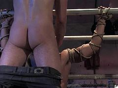 Wolf Hudson gets undressed and tied up by Dominik Rider. He lies on a bike and gets ass fucked from behind.