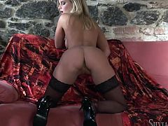 Gorgeous blonde babe Merry Queen wearing stockings has a terrific body and she likes to show it off. She strokes her beautiful tits and smooth pussy and enjoys herself.