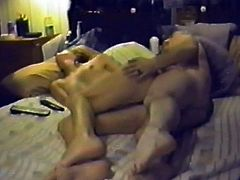 Naughty brunette chick toys her pussy with a vibrator and while the guy fucks her in a sideways position.