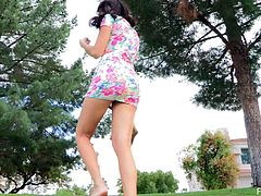 Touch yourself watching this sweet brunette, with born boobs wearing a floral dress, while she fingers her own kitty in a solo model video.