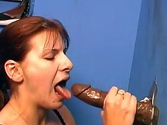 She gets down on her knees and whoops that huge black cock out of that hole! She will be sucking it until he jizzes in her mouth!