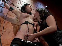 Petite brunette babe gets tied up by Bobbi Starr. Later on Katie gets stimulated with electricity and toyed in her bushy vagina.