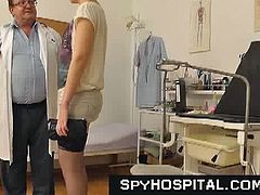 Mature doctor gapes young pussy in the clinic and captures it in hidden camera. This blonde newbie in stockings let grandpa do his thing on her sexy body in the clinic.