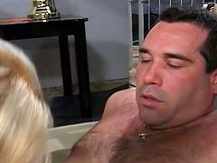 Horny blonde slut with massive tits sucks hard on a huge cock.