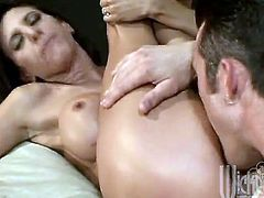 Brunette Lezley Zen gives a great blowjob to warm things up then gets a nice hard fuck in return. In the end her big fake tits are covered with cum.