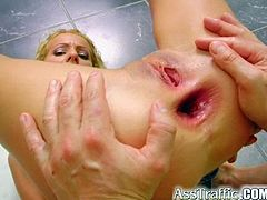 Her ass is so hot and tight she loves those huge white cocks shoved down her mouth and up her tight bare pussy and stretches her asshole gaping fist wide!