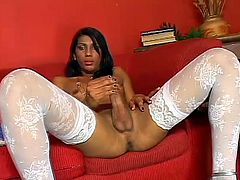 She likes to suck cock just as much as she likes her cock played with! Then she bends over and pulls that swinging dick and takes it up the ass!