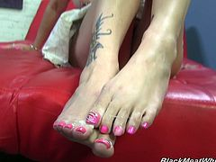 White girl shows off her impressive skills by using her feet to make this horny black guy cum all over her pretty little toes.