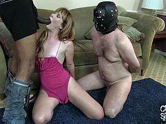A white guy is forced to wear a hood and watch as his sexy wife gets her tight pussy destroyed by a very hung black stud.