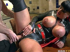 His busty hot wife Kerry Louise is dangerously sexy in her super hero uniform. He catches in her outfit in the kitchen with her massive melons out. She takes his big dick in her pussy without taking off her latex suit.