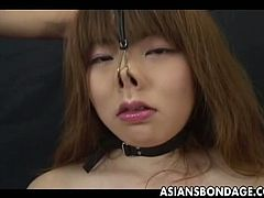 Submissive Japanese woman treated like a submissive pig and tortured with a gag around her mouth. TIt has a hole and her master can stick his cock deep down her throat.
