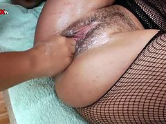 Short-haired brunette bitch with hairy cunt gets fisted by a blondie doggystyle and lying on the white leather couch in steamy Filthy and Fisting xxx video!