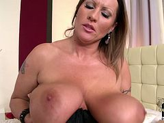 BBW mature bitch plays with her enormous saggy udders in bed