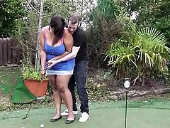 This guy is trying to teach this fat ebony babe some techniques for golf, but she's thinking of something else. She touches him and suggests him she wants to get fucked. He gives her his white meat.