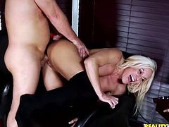 Ashley Starr takes a dress off. She smokes the cigar while a guy licks her tits. Horny MILF also blows a dick and gets fucked hard as she likes.