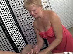 Tracy has just come back from the pool, finding Billy, naked in the living room. The naughty lady does not miss any time and grabs this big-sized boner. She jerks him for good.
