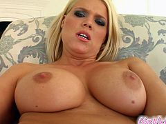 Get a hard dick watching this blonde doll, with giant boobs wearing fishnets and stockings, while she touches herself with a big dildo.