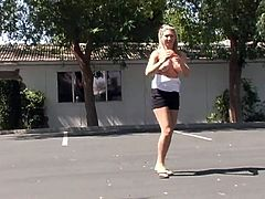Alison Angel shows off her daring side when she pulls down her top and bares her great tits while in a public parking lot.
