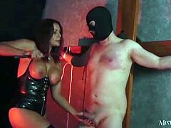 I tease my slave until he is nice and hard then pull out my syringe and drain every single last drop of sperm, he moans and groans with sheer pleasure throughout the entire session!