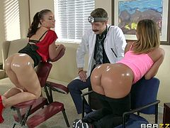Jada Stevens and Mischa Brooks are two sexy ladies with perfect round asses. They show their bare oiled up bottom to Doctor Xander Corvus. He explores their butts and then they suck his dick with their amazing a