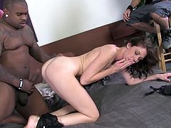 Check this brunette MILF, with natural tits wearing high heels, while she has interracial sex with a black dude in front of her cuckold.