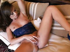 Capri Anderson with clean pussy strips and plays with her twat