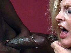 Mature blonde throats cock like a true master during top oral show