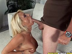 Captivating blonde mom Holly Halston gives a blowjob and a titjob to some guy. Then they fuck in cowgirl position and doggy style and Holly moans sweetly with pleasure.