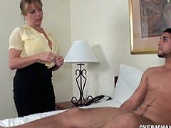 Jimmy was watching porn and stroking his cock when milf Amber Bach walked in. She got naked and showed him how it is supposed to be done. She didn't need long.