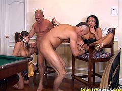 Two nasty girls are playing dirty games with two horny dudes. The bitches let the men rub their shaved cunts and then sit down on the schlongs and ride them crazily.