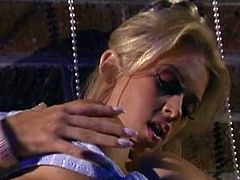 Salacious blonde Jenna Jameson is having fun indoors. She kneads her big boobs and fingers her cunt and then uses a pearl necklace to toy her pink slit.