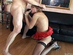 Busty blonde tranny Astrid Shay wearing sexy lingerie and stockings is having fun with some guy indoors. She pleases the dude with a deepthroat blowjob and then lets him fuck her butt doggy style.