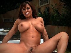 Dangerously hot mature Latina with huge melons fucks herself with a small toy.