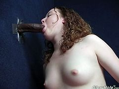 Nasty chick with curly hair takes clothes off in a special room with a hole in the wall. Some Black guy pushes his big cock through the hole and Mercedes gives him an amazing blowjob.