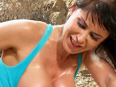 Brunette MILF fingers her pussy and also gives a blowjob somewhere in the mountains. Then she gets fucked in her pussy and ass through the hole in her leggings.
