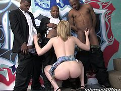 Great bukkake cum shot! These black cocks are all down this girls face, she has a gorgeous body that she uses to jack those cocks to blow loads on her face!