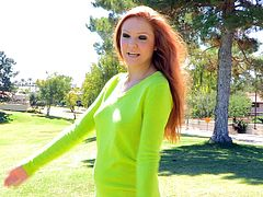 Get a hard dick watching this redhead babe, with natural jugs and a nice ass, while she jumps and plays around in the middle of a park.