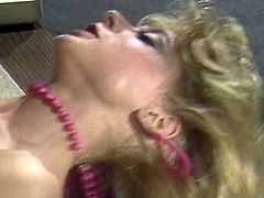Sexy blonde bitch seduces her boss for sex. She gives him solid blowjob before riding hard dong on top. Then she gets screwed missionary style. Arousing retro porn video featuring porn legend Nina Hartley.