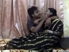 Lusty Indian gal strips and gives head to horny desi