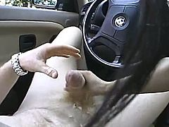 Hot Asian chick is playing dirty games with her man in a car. She lets the dude finger her pussy and drives him crazy with a passionate handjob.