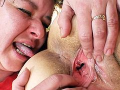 Mature ladies are having a rough time by masturbating eachother's hairy twats