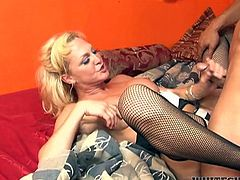 Old busty TS blondie gets her penis passionately eaten