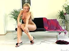Check out this heart stopping solo scene where the gorgeous blonde Silvia Saint takes off her clothes and plays with her pink pussy while wearing stockings.