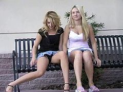 While posing with another hot blonde in public, Alison strips down and has some lesbian fun while people walk by and snap pictures.