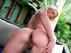 Anikka Albrite gives herself some muff pie stimulation with the help of her sex toy