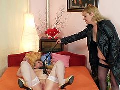 Horny moms are having a great time dominating one another in lesbian show
