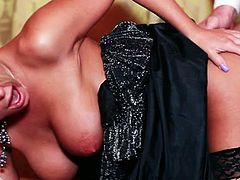 Bosomy blondie in black fishnets gets her saggy vag spoon style banged