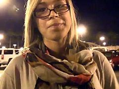 Kinky blonde chick Kennedy wearing glasses is getting naughty in the street. She flashes her nice natural boobs for the cam and feels proud of herself.