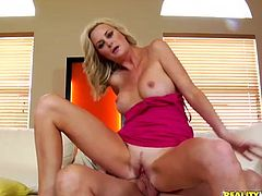 Captivating blonde milf Camryn Cross shows her beautiful boobs to some guy and drives him crazy with a blowjob. Then she jumps on his weiner and seems to be unable to stop.